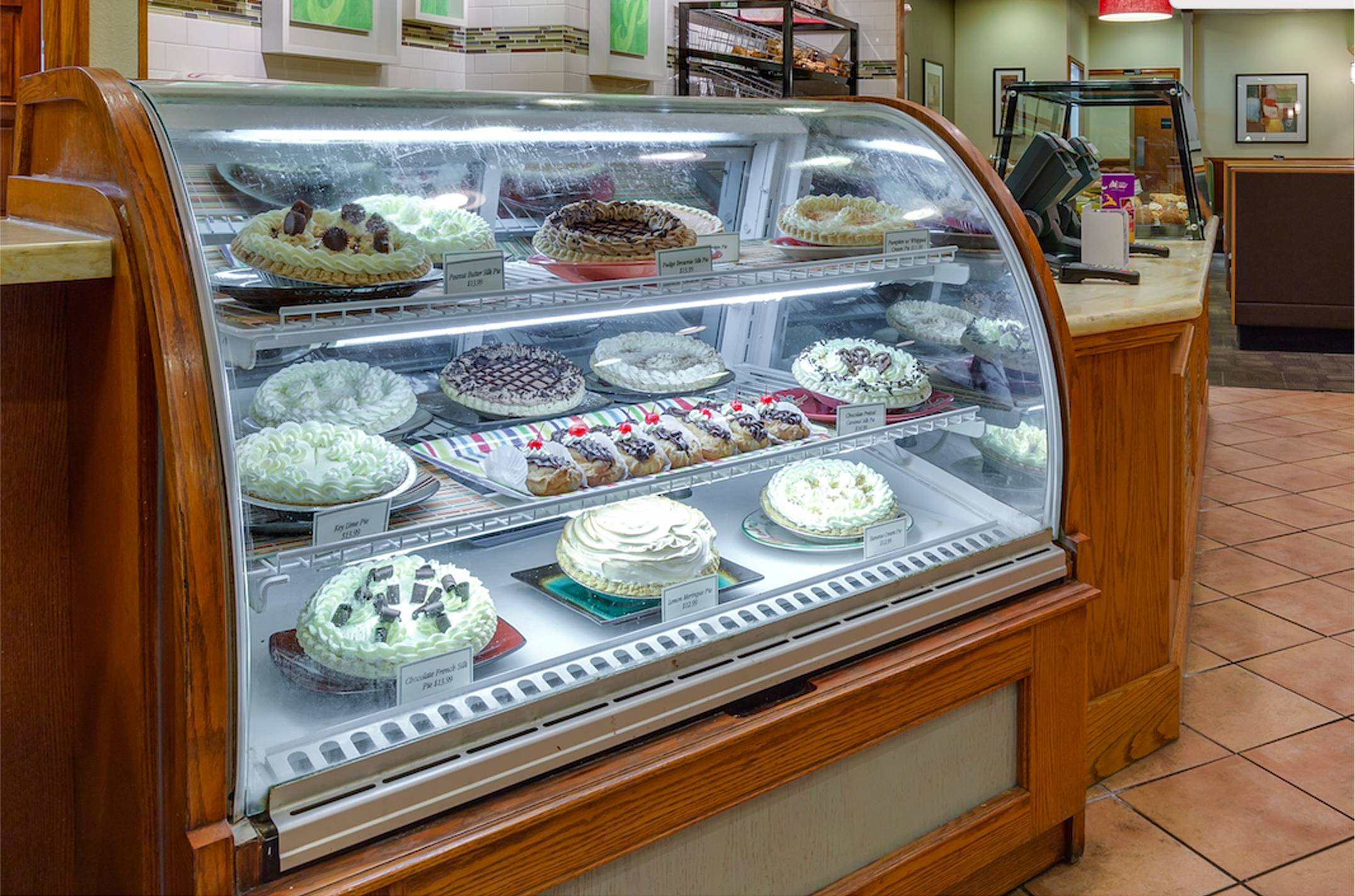 a rack of desserts by Perkins